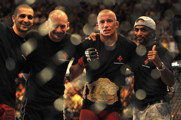 LAS VEGAS - JULY 11:  (2nd R) Georges St. Pierre celebrates his victory against Thiago Alves during their welterweight title bout during UFC 100 on July 11, 2009 in Las Vegas, Nevada. St. Pierre defeated Alves by unanimous decision.  (Photo by Jon Kopaloff/Getty Images)