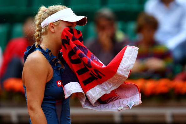 PARIS, FRANCE - MAY 27:  Caroline Wozniacki of Denmark wipes her face with a towel as she shows her dejection during the women's singles round three match between Caroline Wozniacki of Denmark and Daniela Hantuchova of Slovakia on day six of the French Open at Roland Garros on May 27, 2011 in Paris, France.  (Photo by Clive Brunskill/Getty Images)