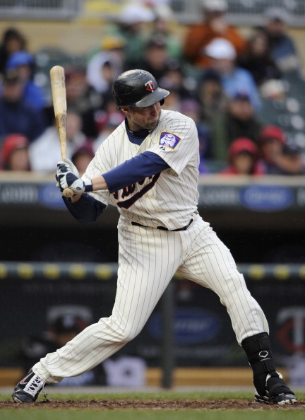 MINNEAPOLIS, MN - MAY 14: Michael Cuddyer #5 of the Minnesota Twins hits a solo home run against the Toronto Blue Jays in the sixth inning on May 14, 2011 at Target Field in Minneapolis, Minnesota. Blue Jays defeated the Twins 9-3 in eleven innings. (Photo by Hannah Foslien/Getty Images)
