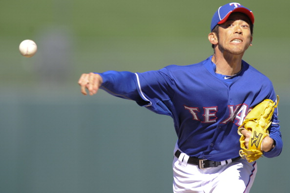 SURPISE, AZ - FEBRUARY 27: Yoshinori Tateyama #22 of the Texas Rangers pitches during a spring training game against the Kansas City Royals at Surprise Stadium on February 27, 2011 in Surprise, Arizona. (Photo by Rob Tringali/Getty Images)