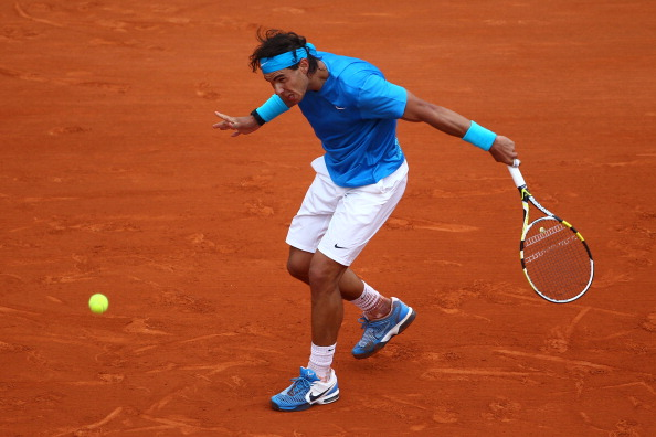 PARIS, FRANCE - MAY 30:  Rafael Nadal of Spain hits a backhand during the men's singles round four match between Rafael Nadal of Spain and Ivan Lubicic of Croatia on day nine of the French Open at Roland Garros on May 30, 2011 in Paris, France.  (Photo by Clive Brunskill/Getty Images)
