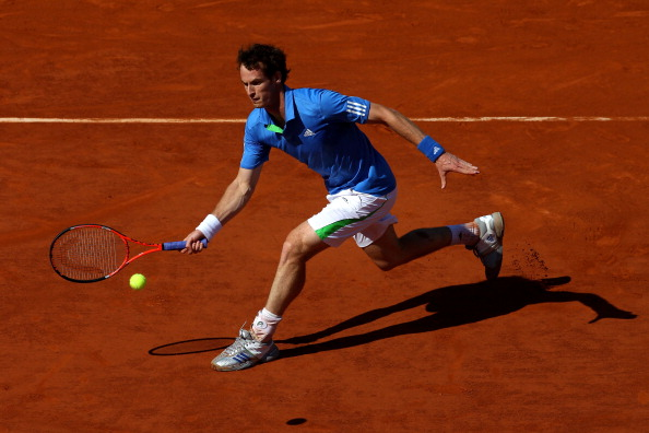 PARIS, FRANCE - JUNE 01:  Andy Murray of Great Britain hits a forehand during the men's singles quarterfinal match between Andy Murray of Great Britain and Juan Ignacio Chela of Argentina on day eleven of the French Open at Roland Garros on June 1, 2011 in Paris, France.  (Photo by Alex Livesey/Getty Images)