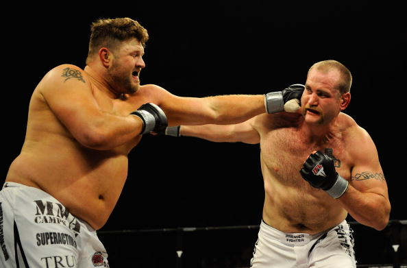 UNCASVILLE, CT - MAY 16:  Roy Nelson (L) of the Lions Den throws a punch at Brad Imes (R) MilesTech Fighting System during their bout presented by the International Fighting League at the Mohegan Sun Arena May 16, 2008 in Uncasville, Connecticut.  (Photo by Jeff Zelevansky/Getty Images for IFL)