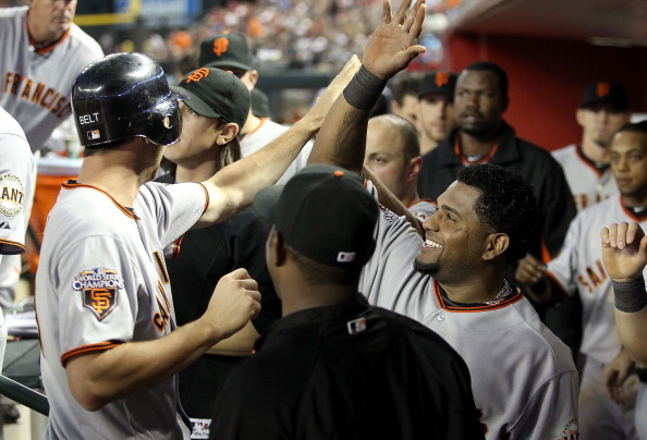 PHOENIX, AZ - APRIL 16:  Pablo Sandoval #48 of the San Francisco Giants high fives teammate Brandon Belt #9 after he scored a seventh inning run against the Arizona Diamondbacks during the Major League Baseball game at Chase Field on April 16, 2011 in Phoenix, Arizona.  (Photo by Christian Petersen/Getty Images)