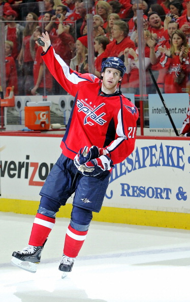 WASHINGTON , DC - APRIL 23:  Brooks Laich #21 of the Washington Capitals celebrates being named the third star of the game against the New York Rangers in Game Five of the Eastern Conference Quarterfinals during the 2011 NHL Stanley Cup Playoffs at the Verizon Center on April 23, 2011 in Washington, DC. The Capitals defeated the Rangers 3-1 to clinch the series in five games.  (Photo by Len Redkoles/Getty Images)