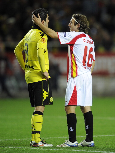 SEVILLE, SPAIN - DECEMBER 15:  Diego Capel of Sevilla (L) talks to Nuri Sahin at the end of the UEFA Europa League group J match between Sevilla and Borussia Dortmund at Estadio Ramon Sanchez Pizjuan on December 15, 2010 in Seville, Spain. The match ended 2-2.  (Photo by David Ramos/Getty Images)