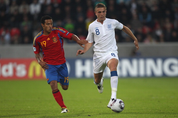 HERNING, DENMARK - JUNE 12:  Jordan Henderson (R) of England is tracked by Thiago Alcantara (L) during the UEFA European Under-21 Championship Group B match between England and Spain at the Herning Stadium on June 12, 2011 in Herning, Denmark.  (Photo by Michael Steele/Getty Images)