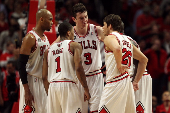 CHICAGO, IL - MAY 18:  (L-R) Taj Gibson #22, Derrick Rose #1, Omer Asik #3 and Kyle Korver #26 of the Chicago Bulls huddle up against the Miami Heat in Game Two of the Eastern Conference Finals during the 2011 NBA Playoffs on May 18, 2011 at the United Center in Chicago, Illinois. The Bulls won 85-75. NOTE TO USER: User expressly acknowledges and agrees that, by downloading and or using this photograph, User is consenting to the terms and conditions of the Getty Images License Agreement.  (Photo by Jonathan Daniel/Getty Images)