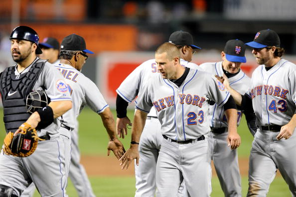 BALTIMORE - JUNE 11:  Chris Carter #23 of the New York Mets celebrates with teammates after a 5-1 victory against the Baltimore Orioles at Camden Yards on June 11, 2010 in Baltimore, Maryland.  (Photo by Greg Fiume/Getty Images)