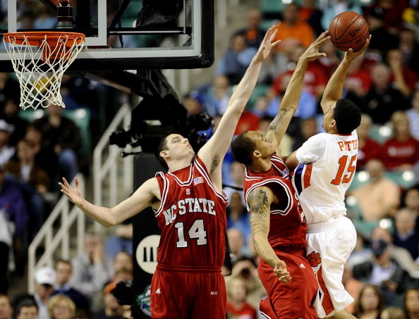 GREENSBORO, NC - MARCH 11:  David Potter #15 of the Clemson Tigers shoots over Jordan Vandenberg #14 and Julius Mays #24 of the NC State Wolfpack in their first round game in the 2010 ACC Men's Basketball Tournament at the Greensboro Coliseum on March 11, 2010 in Greensboro, North Carolina.  (Photo by Jeff Zelevansky/Getty Images)