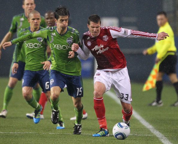 SEATTLE, WA - MAY 14:  Kenny Cooper #33 of the Portland Timbers dribbles against Alvaro Fernandez #15 of the Seattle Sounders FC at Qwest Field on May 14, 2011 in Seattle, Washington. (Photo by Otto Greule Jr/Getty Images)
