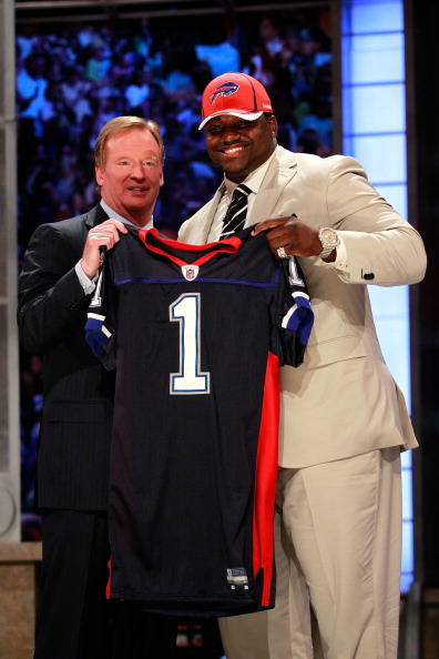 NEW YORK, NY - APRIL 28:  NFL Commissioner Roger Goodell poses for a photo with Marcell Dareus, #3 overall pick by the Buffalo Bills, as Dareus holds up a jersey during the 2011 NFL Draft at Radio City Music Hall on April 28, 2011 in New York City.  (Photo by Chris Trotman/Getty Images)