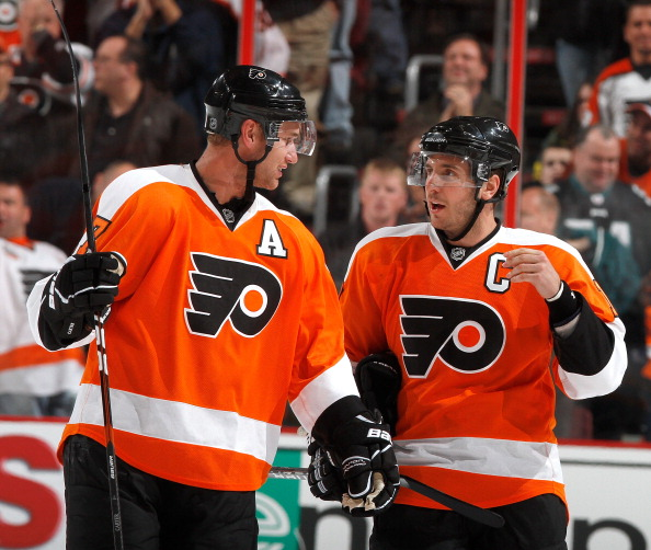 PHILADELPHIA, PA - FEBRUARY 03:  Jeff Carter #17 and Mike Richards #18 of the Philadelphia Flyers talk during a break in action in an NHL hockey game against the Nashville Predators at the Wells Fargo Center on February 3, 2011 in Philadelphia, Pennsylvania.  (Photo by Paul Bereswill/Getty Images)