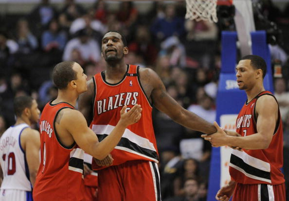LOS ANGELES, CA - JANUARY 26: Greg Oden #52 of the Portland Trail Blazers celebrates with teammates Brandon Roy #7 and Jerryd Bayless #4 during their game against the Los Angeles Clippers at Staples Center January 26, 2009 in Los Angeles, California. NOTE TO USER: User expressly acknowledges and agrees that, by downloading and/or using this Photograph, user is consenting to the terms and conditions of the Getty Images License Agreement. (Photo by Kevork Djansezian/Getty Images)