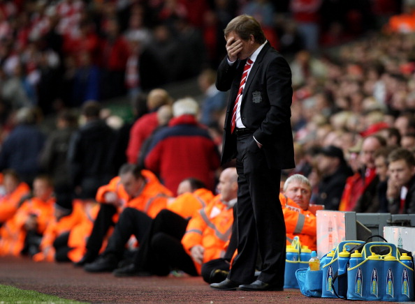 LIVERPOOL, ENGLAND - MAY 15:  A dejected Kenny Dalglish the Liverpool manager looks on as his team head towards a 2-0 defeat during the Barclays Premier League match between Liverpool and Tottenham Hotspur at Anfield on May 15, 2011 in Liverpool, England.  (Photo by Michael Steele/Getty Images)