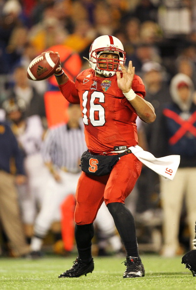 ORLANDO, FL - DECEMBER 28:  Russell Wilson #16 of the North Carolina State Wolfpack passes the ball during the Champs Sports Bowl against the West Virginia Mountineers at Florida Citrus Bowl Stadium on December 28, 2010 in Orlando, Florida.  (Photo by Mike Ehrmann/Getty Images)