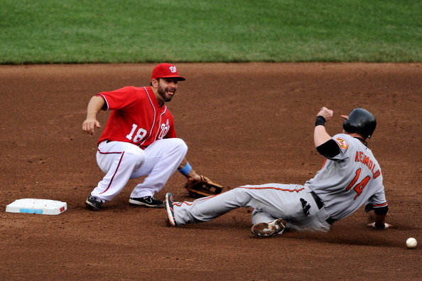 WASHINGTON, DC - JUNE 19: Second basemen Danny Espinosa #18 of the Washington Nationals tries to tag out Nolan Reimold #14 of the Baltimore Orioles after he steals in the seventh inning at Nationals Park on June 19, 2011 in Washington, DC. The Baltimore Orioles won, 7-4. (Photo by Patrick Smith/Getty Images)