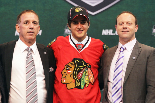 ST PAUL, MN - JUNE 24:  26th overall pick Phillip Danault by the Chicago Blackhawks stands onstage for a photo with General Manager Stan Bowman of the Chicago Blackhawks (R) during day one of the 2011 NHL Entry Draft at Xcel Energy Center on June 24, 2011 in St Paul, Minnesota.  (Photo by Bruce Bennett/Getty Images)
