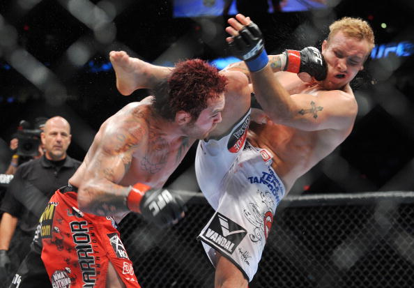 PORTLAND, OR - AUGUST 29:  UFC fighter Chris Leben (L) battles UFC fighter Jake Rosholt (R) during their Middleweight bout at UFC 102:  Couture vs. Nogueira at the Rose Garden Arena on August 29, 2009 in Portland, Oregon.  (Photo by Jon Kopaloff/Getty Images)