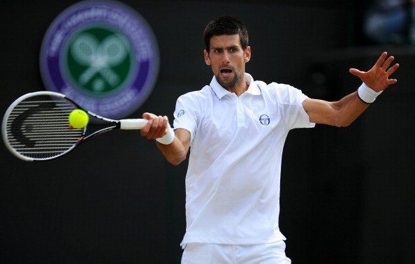 LONDON, ENGLAND - JUNE 29:  Novak Djokovic of Serbia returns a shot during his quarterfinal round match against Bernard Tomic of Australia on Day Nine of the Wimbledon Lawn Tennis Championships at the All England Lawn Tennis and Croquet Club on June 29, 2011 in London, England.  (Photo by Clive Mason/Getty Images)