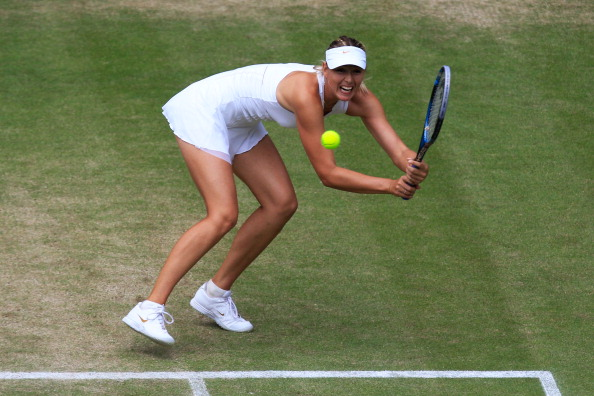 LONDON, ENGLAND - JUNE 30:  Maria Sharapova of Russia returns a shot during her semifinal round match against  Sabine Lisicki of Germany on Day Ten of the Wimbledon Lawn Tennis Championships at the All England Lawn Tennis and Croquet Club on June 30, 2011 in London, England.  (Photo by Suzanne Plunkett/Pool/Getty Images)