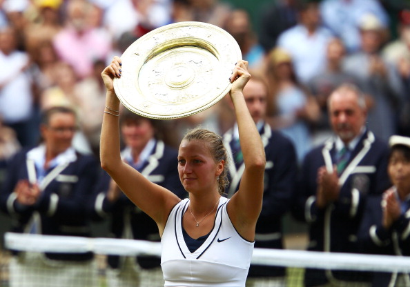 LONDON, ENGLAND - JULY 02:  Petra Kvitova of the Czech Republic holds up the Championship trophy after winning her Ladies' final round match against Maria Sharapova of Russia on Day Twelve of the Wimbledon Lawn Tennis Championships at the All England Lawn Tennis and Croquet Club on July 2, 2011 in London, England.  Kvitova won 6-3 6-4.  (Photo by Clive Brunskill/Getty Images)