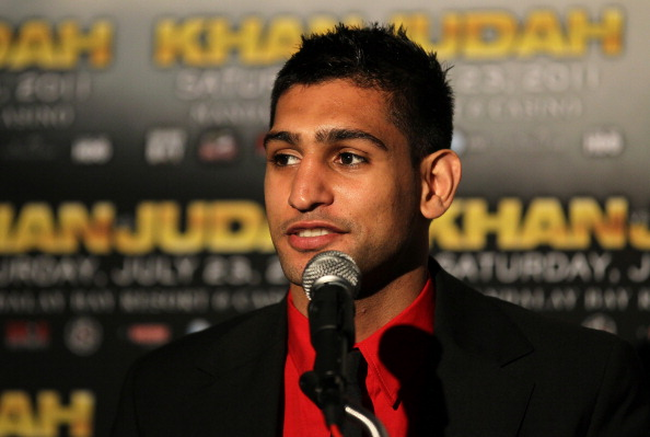 LOS ANGELES, CA - JUNE 08:  Amir Khan speaks as he appears with Zab Judah at a press conference to discuss their upcoming Super Lightweight World Championship Unification Fight at ESPN Zone At L.A. Live on June 8, 2011 in Los Angeles, California.  (Photo by Stephen Dunn/Getty Images)
