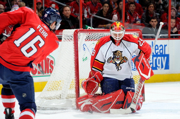 WASHINGTON, DC - DECEMBER 9:  Tomas Vokoun #29 of the Florida Panthers makes a save against Eric Fehr #16 of the Washington Capitals at the Verizon Center on December 9, 2010 in Washington, DC.  (Photo by Greg Fiume/Getty Images)