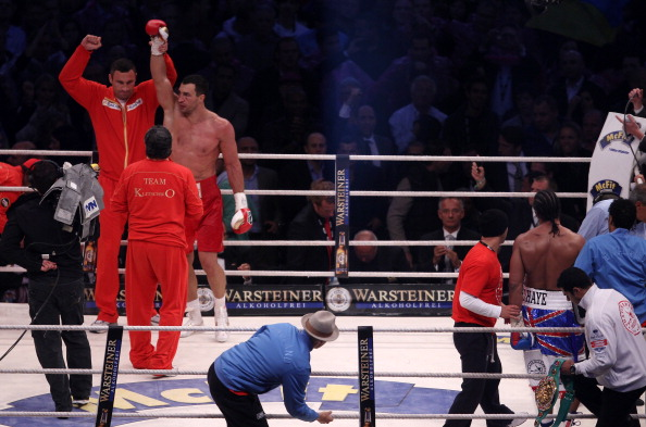 HAMBURG, GERMANY - JULY 02:  Wladimir Klitschko celebrates with his brother Vitali Klitschko on the final bell after his heavey weight title fight with David Haye at the Imtech Arena on July 2, 2011 in Hamburg, Germany.  (Photo by Scott Heavey/Getty Images)