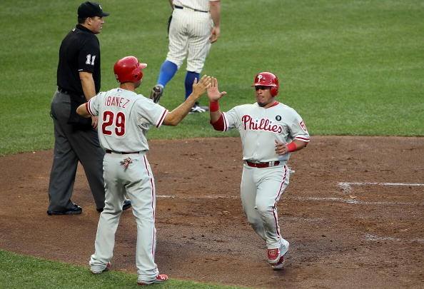 NEW YORK, NY - JULY 15:  Raul Ibanez #29 and Carlos Ruiz #51 of the Philadelphia Phillies score in the second inning against the New York Mets at Citi Field on July 15, 2011 in the Flushing neighborhood of the Queens borough of New York City.  (Photo by Jim McIsaac/Getty Images)