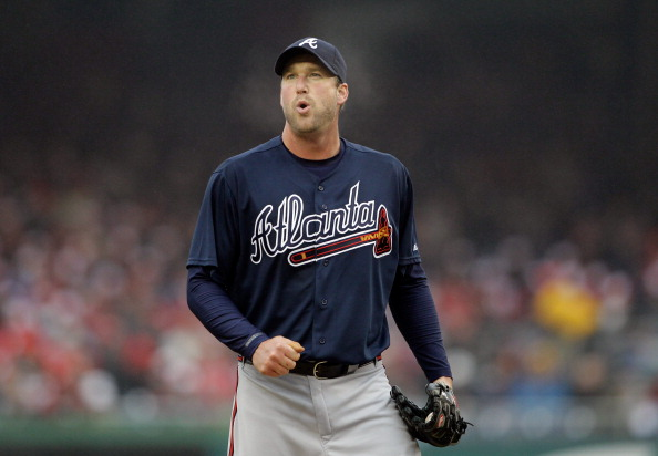 WASHINGTON, DC - MARCH 31:  Starting pitcher Derek Lowe #32 of the Atlanta Braves reacts during the game against the Washington Nationals during the third inning on opening day at Nationals Park on March 31, 2011 in Washington, DC.  (Photo by Rob Carr/Getty Images)