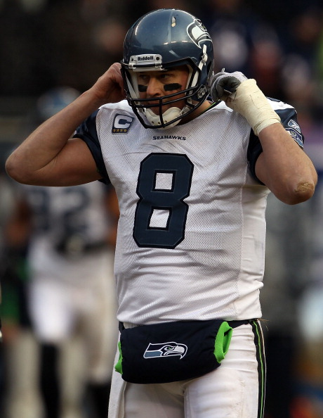 CHICAGO, IL - JANUARY 16:  Quarterback Matt Hasselbeck #8 of the Seattle Seahawks reacts while taking on the Chicago Bears in the 2011 NFC divisional playoff game at Soldier Field on January 16, 2011 in Chicago, Illinois.  (Photo by Jonathan Daniel/Getty Images)