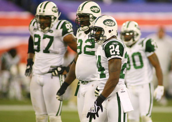 TORONTO - DECEMBER 3: Darrelle Revis #24, Shaun Ellis #92 and Calvin Pace #97 of the New York Jets gets set on defense against the Buffalo Bills at Rogers Centre on December 3, 2009 in Toronto, Canada. The Jets won 19-16.  (Photo by Rick Stewart/Getty Images)
