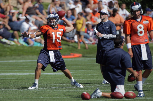 ENGLEWOOD, CO - JULY 28:  (L-R) Tim Tebow #15 and quarterback Kyle Orton #8 of the Denver Broncos take part in training camp at the Paul D. Bowlen Memorial Broncos Centre at Dove Valley on July 28, 2011 in Englewood, Colorado.  (Photo by Doug Pensinger/Getty Images)