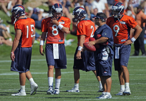 ENGLEWOOD, CO - JULY 28:  (L-R) Quarterbacks Tim Tebow #15, Kyle Orton #8, Adam Weber #2 and Brady Quinn #9 of the Denver Broncos take part in training camp at the Paul D. Bowlen Memorial Broncos Centre at Dove Valley on July 28, 2011 in Englewood, Colorado.  (Photo by Doug Pensinger/Getty Images)