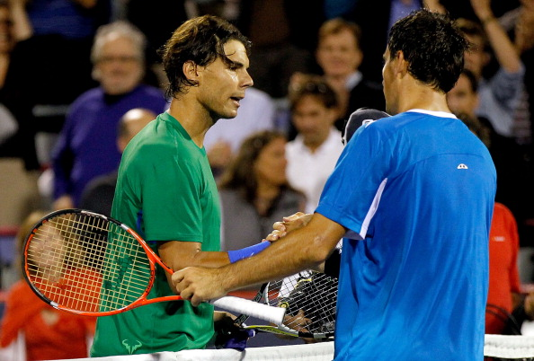 MONTREAL, QC - AUGUST 10:  Rafael Nadal of Spain congratulates Ivan Dodig of Croatia after their match during the Rogers Cup at Uniprix Stadium on August 10, 2011 in Montreal, Canada.  (Photo by Matthew Stockman/Getty Images)