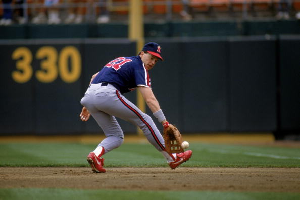 OAKLAND - 1989:  Wally Joyner #21 of the California Angels goes for the ball during their1989 season game at the Oakland Coliseum in Oakland, California. (Photo by:  Otto Greule Jr/Getty Images)