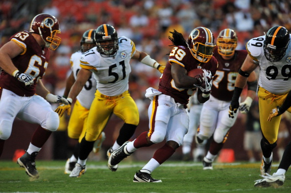 LANDOVER, MD - AUGUST 12:  Tim Hightower #39 of the Washington Redskins runs the ball against the Pittsburgh Steelers at FedExField on August 12, 2011 in Landover, Maryland. The Redskins are tied with the Steelers 7-7 at the half. (Photo by Larry French/Getty Images)