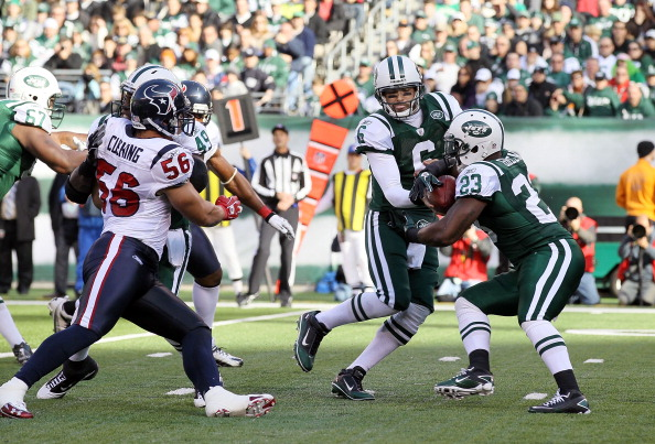 EAST RUTHERFORD, NJ - NOVEMBER 21:  Mark Sanchez #6 of the New York Jets hands the ball to teammate Shonn Greene #23 against the Houston Texans on November 21, 2010 at the New Meadowlands Stadium in East Rutherford, New Jersey.  (Photo by Jim McIsaac/Getty Images)