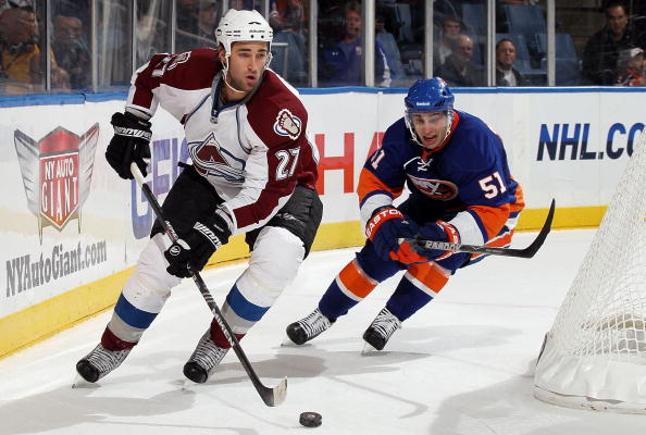 UNIONDALE, NY - OCTOBER 16:  Kyle Quincey #27 of the Colorado Avalanche skates against Frans Nielsen #51 of the New York Islanders on October 16, 2010 at Nassau Coliseum in Uniondale, New York.  (Photo by Jim McIsaac/Getty Images)