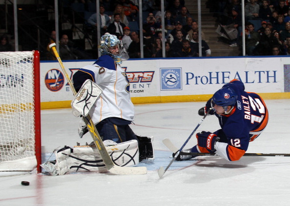 UNIONDALE, NY - MARCH 05: Ben Bishop #30 of the St. Louis Blues sticks aside a shot by Josh Bailey #12 of the New York Islanders at the Nassau Coliseum on March 5, 2011 in Uniondale, New York. The Islanders defeated the Blues 5-2. (Photo by Bruce Bennett/Getty Images)
