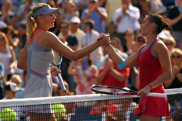 NEW YORK, NY - SEPTEMBER 02:  Flavia Pennetta (R) of Italy shakes hands with Maria Sharapova of Russia after defeating her during Day Five of the 2011 US Open at the USTA Billie Jean King National Tennis Center on September 2, 2011 in the Flushing neighborhood of the Queens borough of New York City.  (Photo by Nick Laham/Getty Images)