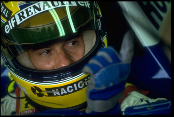 1 MAY 1994:  ARYTON SENNA OF BRAZIL SITS IN HIS WILLIAMS RENAULT IN THE PITS BEFORE THE SAN MARINO GRAND PRIX, IMOLA. MICHAEL SCHUMACHER (BENETTON FORD) WON THE RACE WITH NICOLA LARINI (FERRARI) AND MIKA HAKKINEN (MCLAREN PEUGEOT) COMING SECOND AND THIRDRESPECTIVELY.