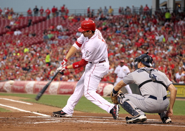 CINCINNATI, OH - AUGUST 13: Joey Votto #19 of the Cincinnati Reds hits a home run during the game against the San Diego Padres at Great American Ball Park on August 13, 2011 in Cincinnati, Ohio.  (Photo by Andy Lyons/Getty Images)