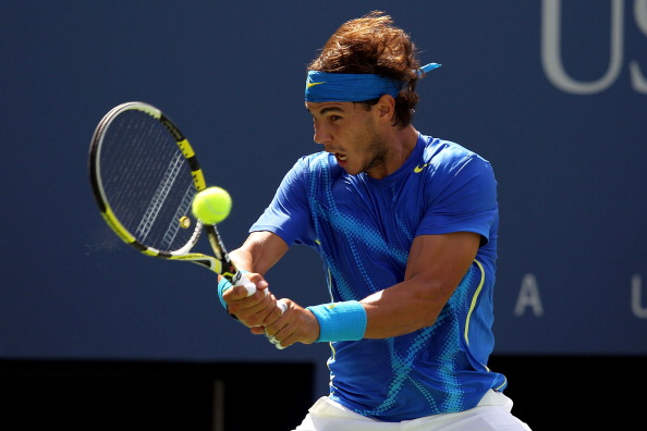 NEW YORK, NY - SEPTEMBER 08:  Rafael Nadal of Spain returns a shot against Gilles Muller of Luxembourg during Day Eleven of the 2011 US Open at the USTA Billie Jean King National Tennis Center on September 8, 2011 in the Flushing neighborhood of the Queens borough of New York City.  (Photo by Nick Laham/Getty Images)