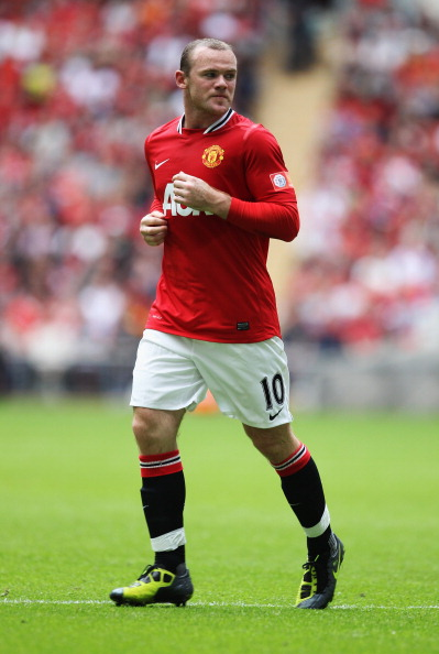 LONDON, ENGLAND - AUGUST 07:  Wayne Rooney of Manchester United in action during the FA Community Shield match sponsored by McDonald's between Manchester City and Manchester United at Wembley Stadium on August 7, 2011 in London, England.  (Photo by Clive Rose/Getty Images)