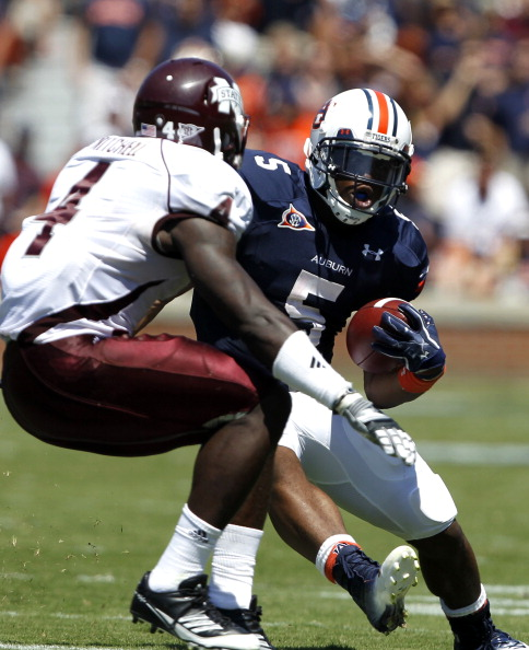 AUBURN, AL - SEPTEMBER 10:  Running back Michael Dyer #5 of the Auburn Tigers tries to get around defensive back Charles Mitchell #4 of the Mississippi State Bulldogs in the second quarter on September 10, 2011 at Jordan-Hare Stadium in Auburn, Alabama. (Photo by Butch Dill/Getty Images)
