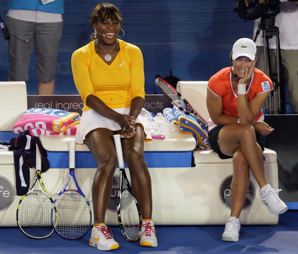 MELBOURNE, AUSTRALIA - JANUARY 17:  Serena Williams of the United States of America and Samantha Stosur of Australia and of the Red Team share a laugh during the 'Hit For Haiti' charity exhibition match ahead of the 2010 Australian Open at Melbourne Park on January 17, 2010 in Melbourne, Australia.  (Photo by Mark Dadswell/Getty Images)