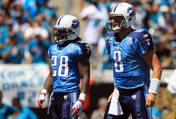 JACKSONVILLE, FL - SEPTEMBER 11:  Matt Hasselbeck #8 of the Tennessee Titans and teammate Chris Johnson watch on against the Jacksonville Jaguars during their season opener at EverBank Field on September 11, 2011 in Jacksonville, Florida.  (Photo by Streeter Lecka/Getty Images)