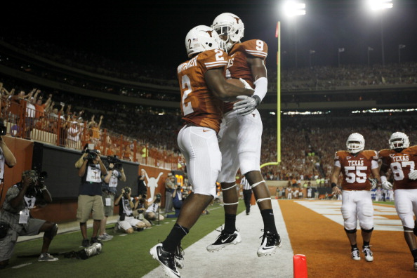 AUSTIN, TX - SEPTEMBER 3:  Running back Fozzy Whittaker #2 and wide receiver John Harris #9 of the Texas Longhorns celebrate a fourth quarter touchdown against the Rice Owls on September 3, 2011 at Darrell K. Royal-Texas Memorial Stadium in Austin, Texas.  (Photo by Erich Schlegel/Getty Images)